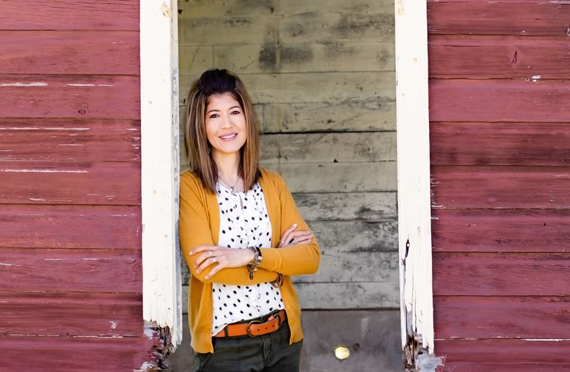 Laura Sandretti - Christian Speaker, Author & Blogger standing in barn window